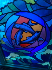 A Trinity of Fish - stained glass window at Maple Grove United Church